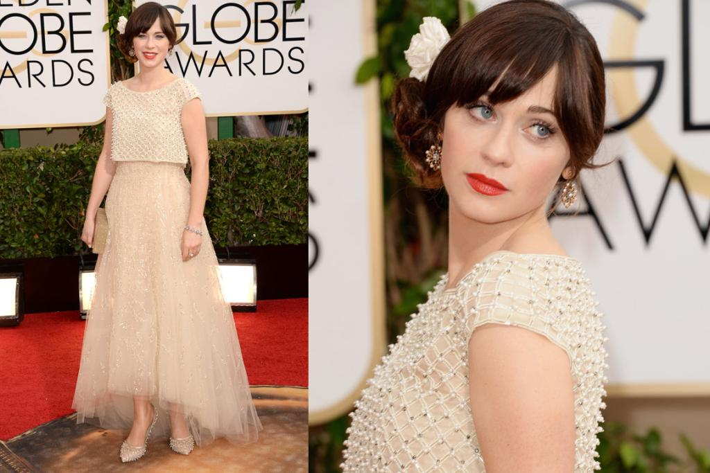 THE GOOD: While I'm not a fan of her one-side-heavy hair, I do actually like this Oscar de la Renta gown and caraco (but maybe I'm blinded by my love for New Girl). While, yes, the top to skirt relationship isn't super flattering, it is super pretty, and it is very Zooey.