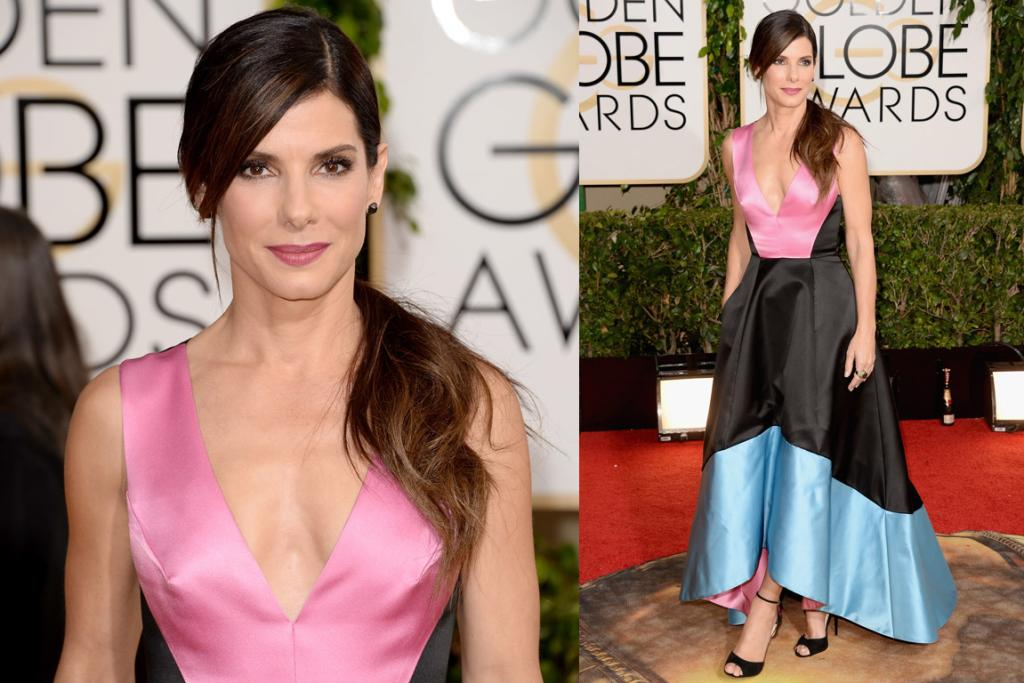 THE I'M JUST NOT SURE: If you explained this pastel-meets-black Prabal Gurung dress to me I would think I'd hate it, but Sandra Bullock somehow makes it work. How does she do it? The only thing that's holding me back from loving it are the colours ... I'd prefer bolder accents and a softer middle.