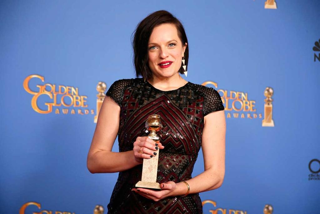Elizabeth Moss holds the Golden Globe she won for playing a New Zealander in Jane Campion's Top of the Lake.