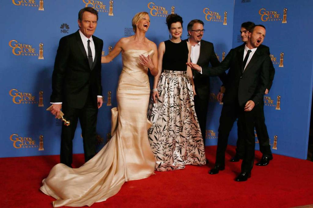 The cast of the drama series Breaking Bad pose backstage after they won the award for Best TV Series, Drama.
