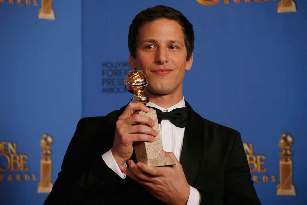 Andy Samberg poses backstage with his award for Best Actor in a TV Series, Musical or Comedy for his role in Brooklyn Nine-Nine.