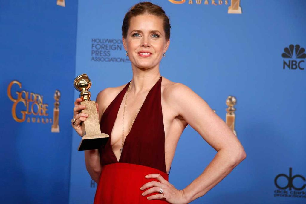 Amy Adams poses with her award for Best Actress In A Motion Picture, Musical or Comedy for her role in the film American Hustle.