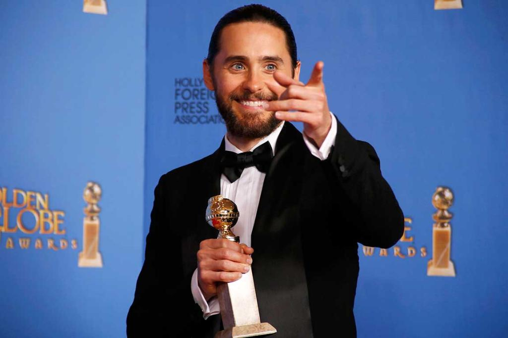 Jared Leto poses backstage with his award for Best Supporting Actor in a Motion Picture for his role in The Dallas Buyers Club.
