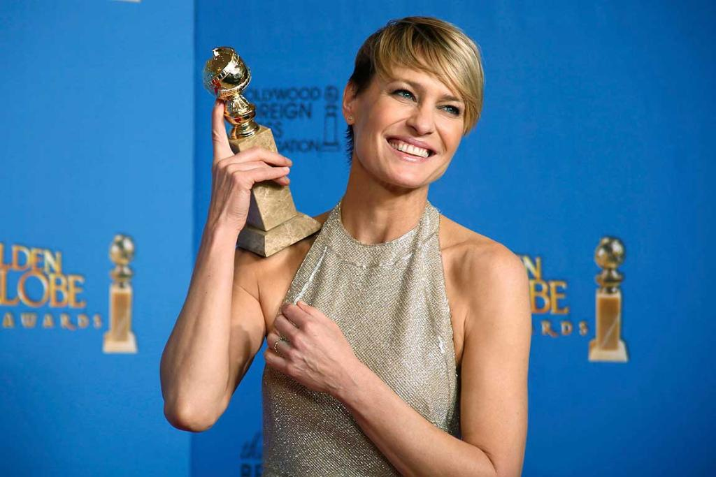 Actress Robin Wright poses with the award for Best Actress in a TV Series, Drama for her role in House of Cards.