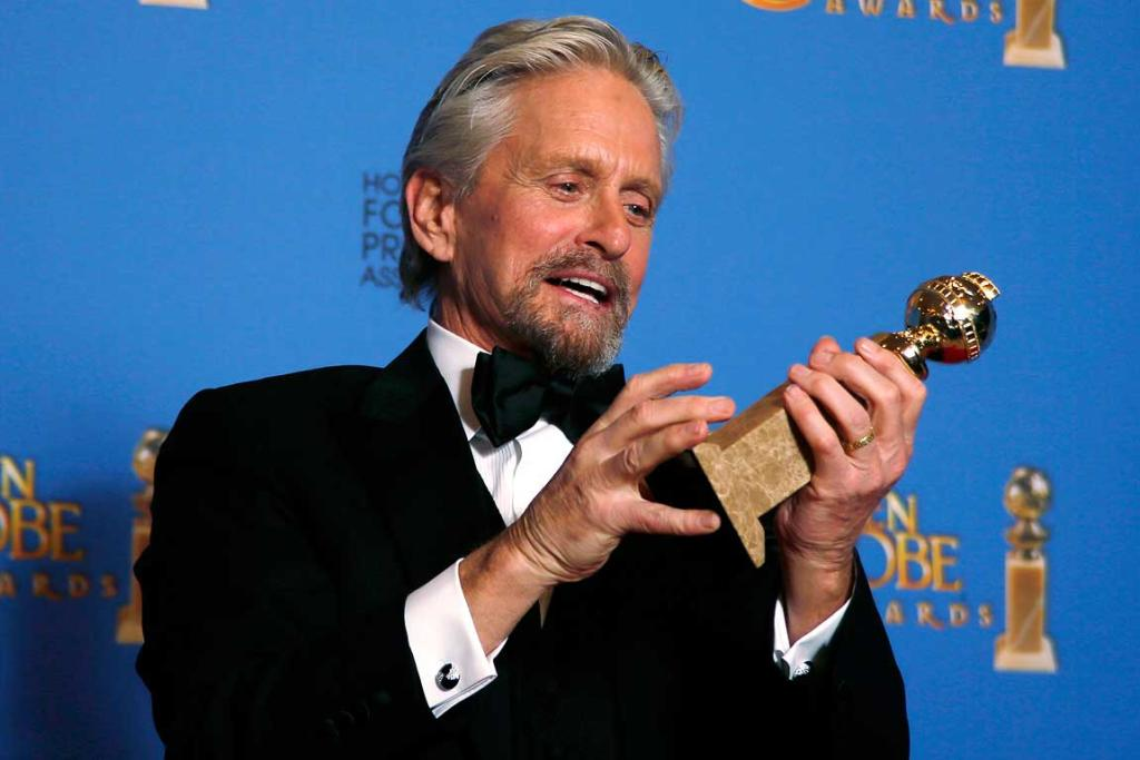 Michael Douglas poses backstage with the award for Best Actor in a Mini-Series or TV Movie for his role in Behind the Candelabra.