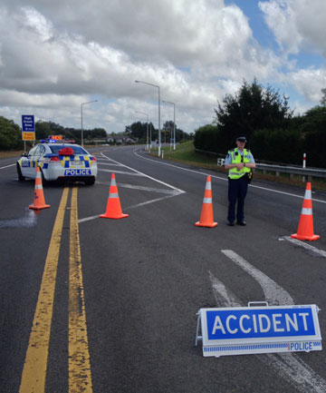 DIVERSION: Police divert traffic away from the site of the crash.