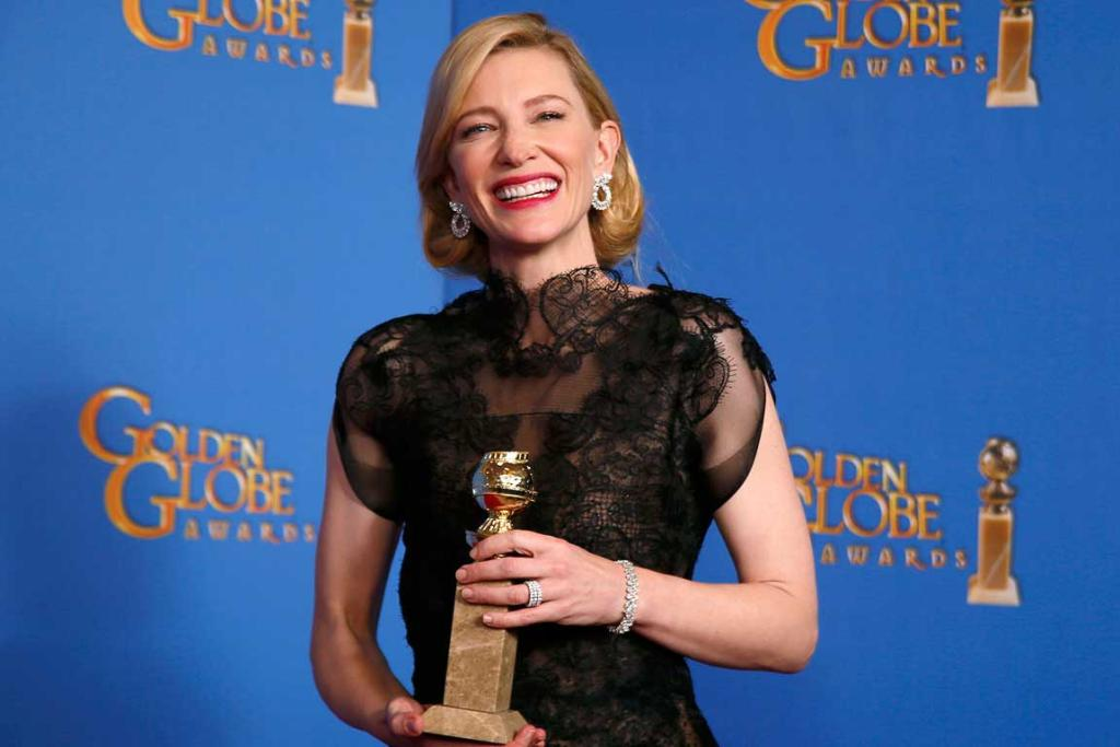 Actress Cate Blanchett poses backstage with her Best Performance by an Actress in a Motion Picture - Drama Award for Blue Jasmine.