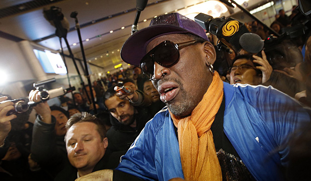 Former NBA basketball player Dennis Rodman speaks to the media upon his arrival from North Korea's Pyongyang, at Beijing Capital International Airport.