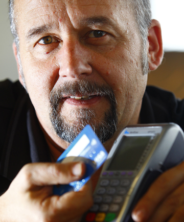 PAY OPTION: Electronic point of sales company Eftco owner Alex Castle holds a payWave card.