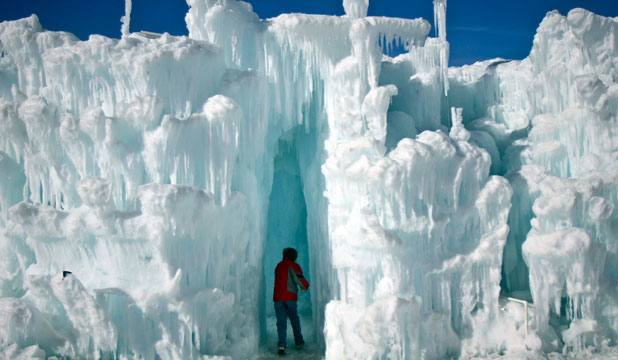 WINTER WONDERLAND: A boy runs though ice formations at the Ice Castles in Colorado.