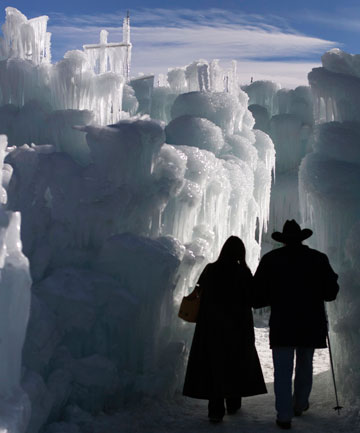 FROZEN LAND: Chipper Williams and Susan Getzug walk through ice formations at the Ice Castles in Colorado.