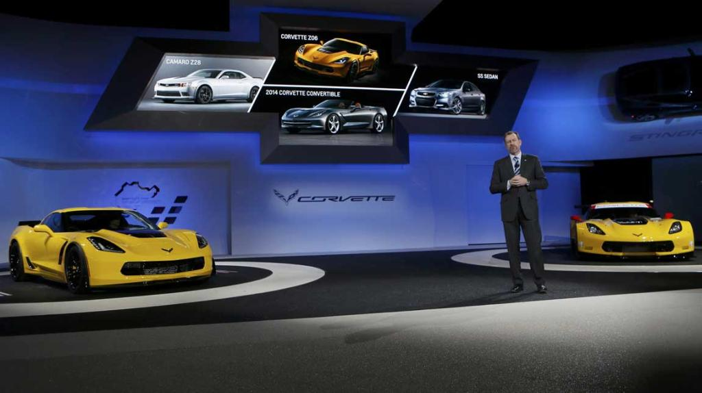 Daniel Ammann, president of GM, speaks between the Chevrolet Corvette Stingray ZO6 street version (left) and the racing version at Detroit Auto Show.