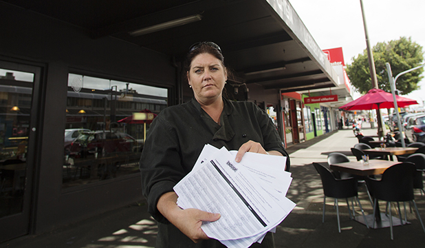 FED UP: Grey Street Kitchen head chef Sara Wright and petition signatures opposing controversial puff shop U njoY which is a few doors down.