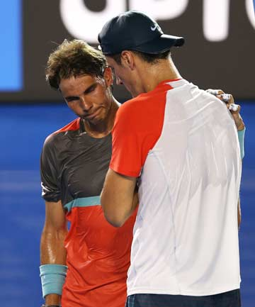 SHORT NIGHT: Rafa Nadal consoles Bernard Tomic after the Australian retired from their first round match at the Australian Open after the first set.