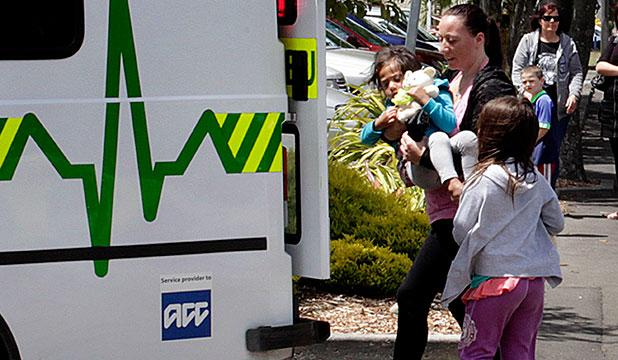 SAVIOUR: Tamsin Duckmanton carries one of the children she saved to a waiting ambulance.