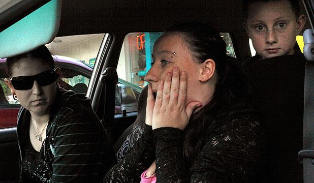 SHOCKED: Tamsin Duckmanton sits in her car, in shock, reflecting on the day's events.