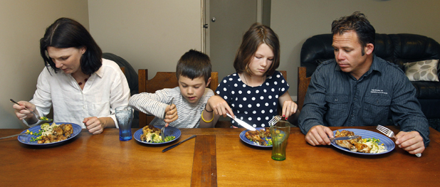 We are family:  The Frisken family often have extra mouths to feed at the  table. From left are Megan Thomas, Jonty, 8, Anna, 10, and Greg Frisken