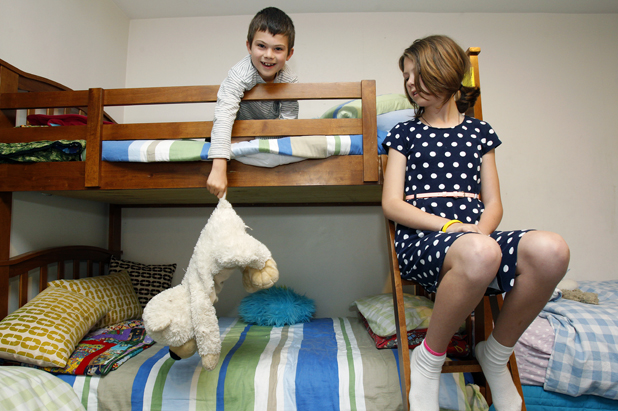 Welcome to our room: Jonty, 8, and Anna Frisken, 10, in the bedroom they share with the children from Child, Youth and Family