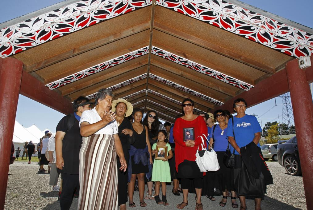 The family wait outside the Marae to be welcomed. Carol McDonald at front sings the karanga.