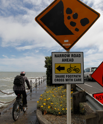 PEDAL POWER: A cyclist rides on the footpath along Rocks Rd.