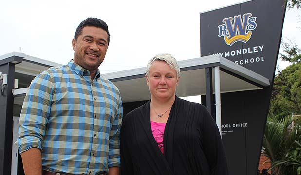 BIG VICTORY: Wymondley Road School principal Pelu Leaupepetele and board member Megan Timu are ecstatic after hearing transport agencies have backed down on motorway plans that would have destroyed their school.