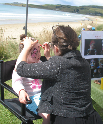 Penny Coote, 5, of Balclutha having her face painted by Elizabeth Dalton from Fun Faces, Dunedin, at the Kaka Point  Market Day.