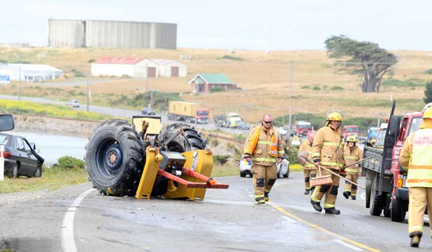 A MESS: The remains of the tractor following the crash.