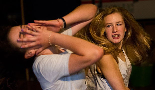 HARD HITTING: Gabriella Lewis, 13, gives Phoebe Allen, 13, a shake-up during Centrepoint Theatre's summer school stage combat class.