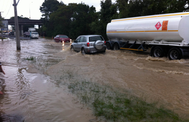 AQUATIC VEHICLE: cars push through a flooded street in Lower Hutt after a water main burst.