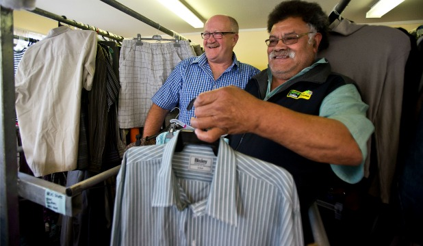 GOODWILL CLOTHING: Lyal Brenton,  of Methodist Social Services Goodwill shops, left, and Wesley Church parishioner Havea Langoia need a helping hand to get cyclone relief clothing to Tonga.