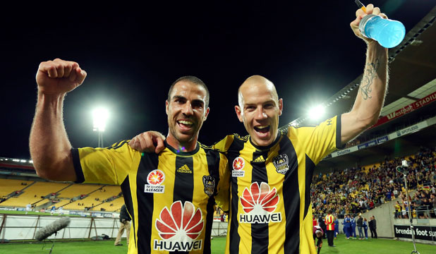 Manny Muscat (left) and Stein Huysegems celebrate after last night's win over Melbourne Victory.