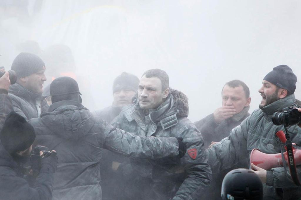 Opposition leader Vitaly Klitschko (centre) reacts after he was sprayed with a powder fire extinguisher.