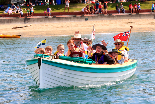 Having a free ride in a home built 16 foot clinker boat is grandparents, Robert and Brenda Burr with their seven grandchildren from the Forman family.  The childrens names are Josiah 3, Beth 5, Charis 7, Sarah 9, Reuben 11, Alicia 13, Caleb 15