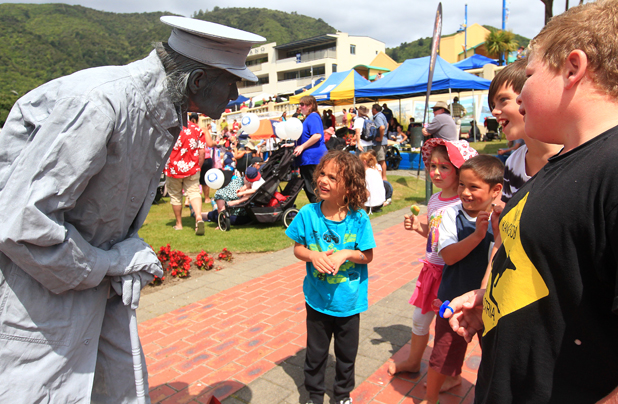 Uriah Kahu, 6, is fascinated by Captain Edwin Fox the statue that moves