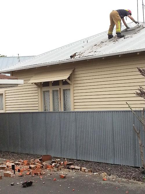 One of two houses to lose chimney's on McGiffert St in Palmerston North.