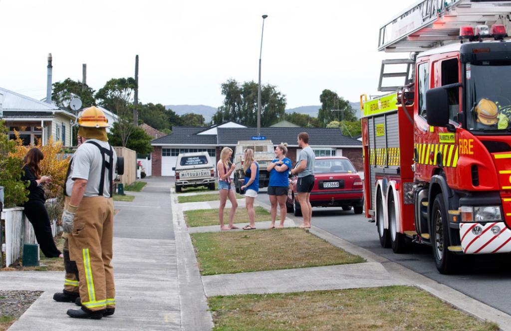 The fire service assists residents in McGriffert Street Palmerston North after an earthquake in the Manawatu and Wairarapa regions today.