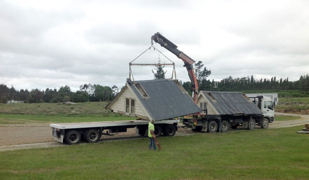 The Ferryman's Cottage roof being transported to Bushtown in December. However, the building is now being de-constructed after it was found to be too unstable, with the risk of it collapsing on itself.