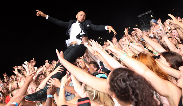 CATCH THIS: Walshy Fire of Major Lazer goes crowd surfing at Big Day Out