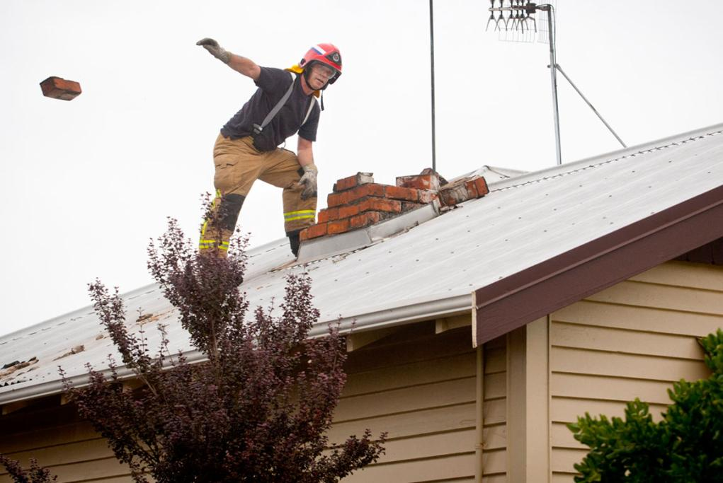 Earthquake in palmerston north. Fixing Katrina Nicholson's chimney on McGriffert St.