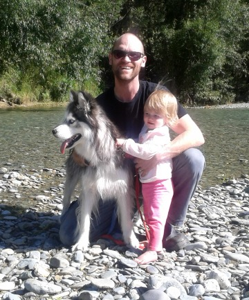Ryan Watt and his daughter, Willow, with their husky, Wolf.