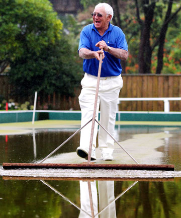 "MOPPING UP:  Supervisor Ian ""Spud"" Andrews got the squeegee out after rain flooded the Fitzroy Bowling Club green on day two of the TSB Bank Taranaki Open Fours Bowls."