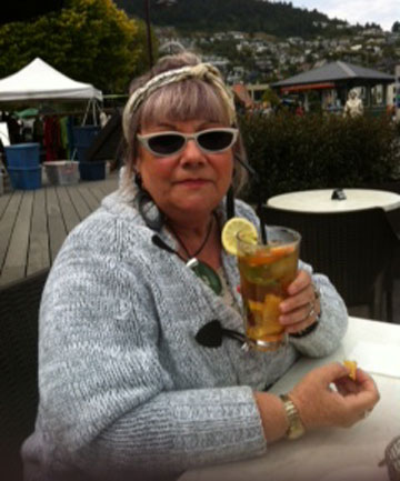 Wendy Steeds enjoying a drink after she ran from under a falling popular in Queenstown.