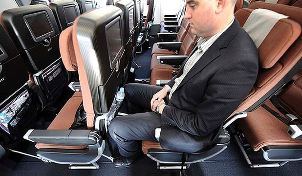 BIG SQUEEZE: Economy seats can be a tight fit for all but the most vertically challenged.