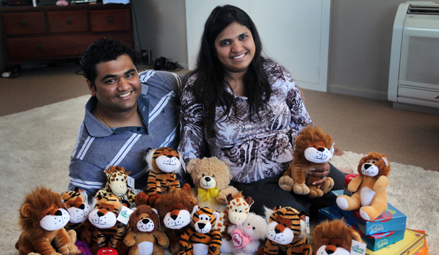 LUCKY LOOT: Husband and wife Vikas and Divya Kanojiya with the prize haul they won at the Caroline Bay Carnival games on New Year's Eve.