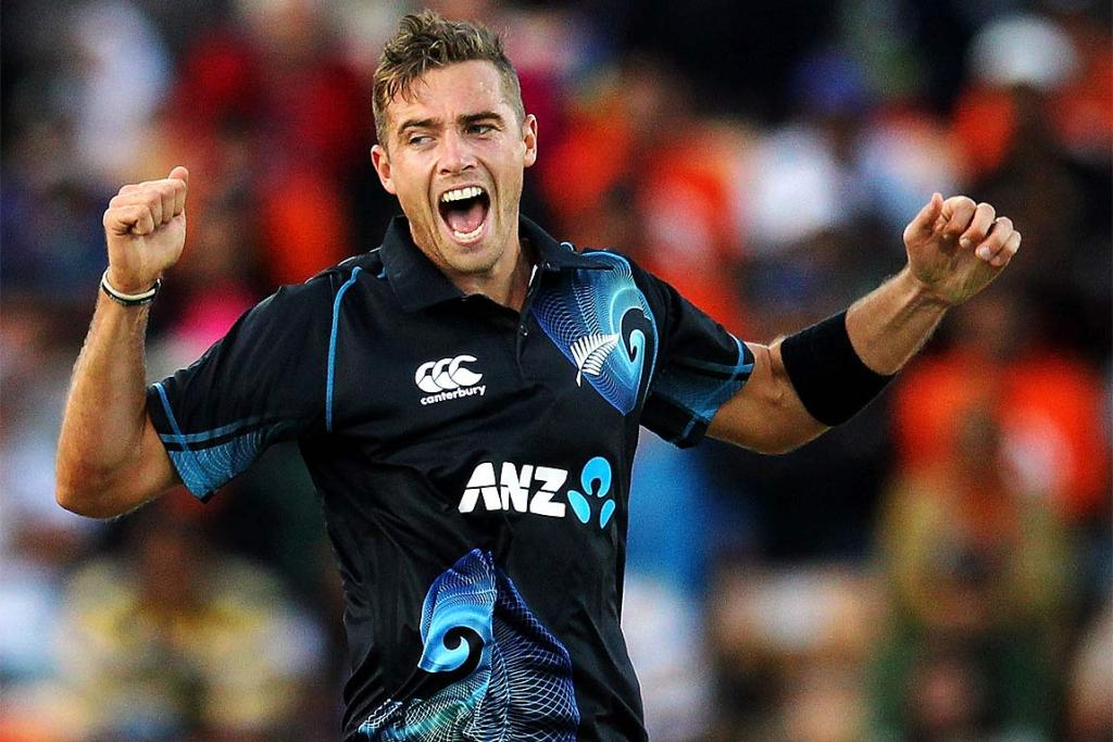 Tim Southee of New Zealand celebrates after taking the wicket of Rohit Sharma.