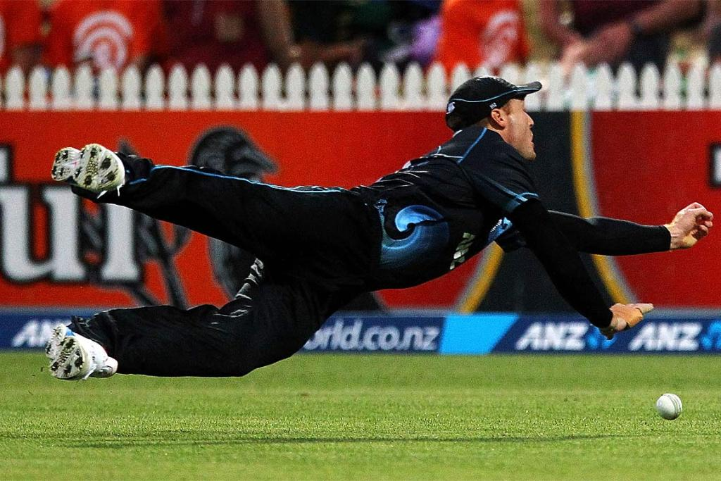 Martin Guptill of New Zealand misses a catch.