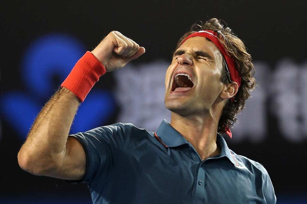 Roger Federer reacts after match point against Andy Murray.