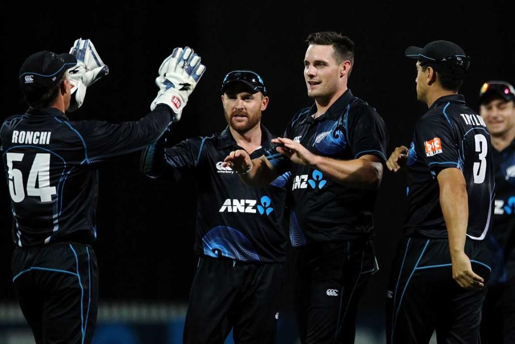 Wicketkeeper Luke Ronchi congratulates Mitchell McClenaghan (right) and Brendon McCullum after dismissing India's Ajinkya Rahane.