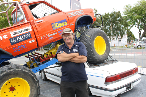 Show and tell: Big Bruvva monster truck owner Neil Jorgensen at The Car Centre on the corner of Boyce and Nelson streets, Blenheim. The display was arranged by The Car Centre owner Phill McNabb to demonstrate how much of the dealership would be shaved off when council buys land to upgrade the road.
