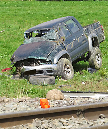 smashed car reefton train crash